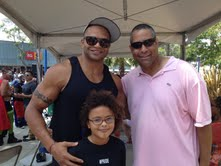 L.A. Pride Honoree Brendon Ayanbadejo with his daughter and MXRS co-founder Mark R. Edwards